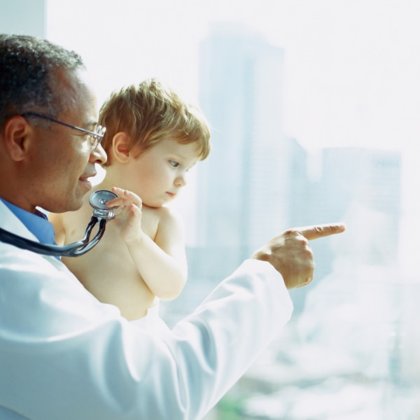 Doctor holding toddler